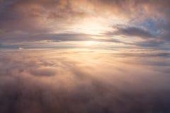 Summer cloudscape. Sunrise over clouds. stock image