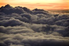 Sunrise over clouds in Hawaii. Stock Photos