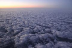 Sunrise over clouds. Looking out airplane window Stock Image