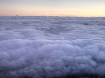 Sunrise over the clouds Stock Photography
