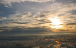 Sunrise over cloudscape. Aerial view of sunrise over cloudscape, with ocean and islands on ground Royalty Free Stock Images