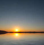 Sunrise over the Coast. The sun rises over calm Mediterranean waters royalty free stock photo
