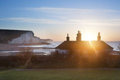 Sunrise over coastguard cottages at Seaford Head with Seven Sisters in background stock images