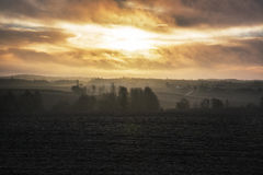 Sunrise over cold foggy autumn morning landscape Royalty Free Stock Photo