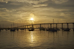 Sunrise over Coronado Bay, San Diego, California, with boats anchored near Coronado Bridge. View from Coronado Island towards the Coronado Bridge stock photo