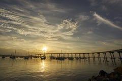 Sunrise over Coronado Bay, San Diego, California welcomes a new day. View from Coronado Island towards the Coronado Bridge royalty free stock photos
