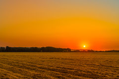 Sunrise over a countryside field Stock Photography