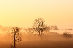 Sunrise over countryside landscape Stock Image