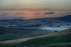 Sunrise over the Crete Senesi Stock Photos