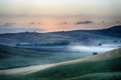 Sunrise over the Crete Senesi Stock Photography