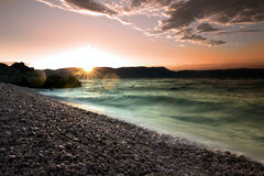 Sunrise over the crystal clear tourquise sea in Croatia, Istria, Europe Royalty Free Stock Photos