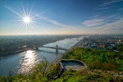 Sunrise over Danube river and Freedom bridge in Budapest. Sunrise over Danube river and Freedom bridge - Szabadsag hid - from Gellert hill in Budapest, Hungary stock photos