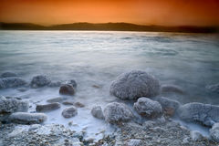 Sunrise over the dead sea. With waves in motion blur Royalty Free Stock Images
