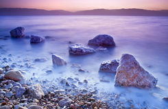 Sunrise over the dead sea. With waves in motion blur Stock Photos
