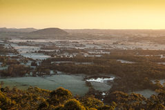 Sunrise over distant hills Stock Photo