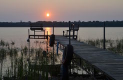 Sunrise over a dock Stock Photo