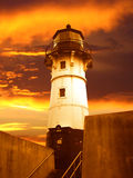 Sunrise over Duluth Lighthouse. A lighthouse stands along the canal in Duluth, Minnesota along Lake Superior Royalty Free Stock Photo