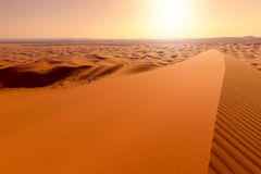 Sunrise over dunes of Erg Chebbi, Sahara, Merzouga, Morocco Royalty Free Stock Photography