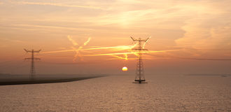 Sunrise over the Dutch sea with two electricity Stock Photography