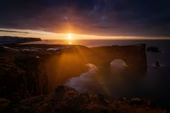 Sunrise over Dyrholaey. Beautiful sunrise over Dyrholaey cliffs and rocky arch, Iceland stock image