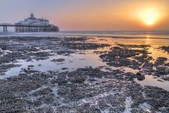 Sunrise over Eastbourne pier. UK Stock Image