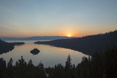 Sunrise over Emerald Bay, Lake Tahoe, California. Sunrise over Emerald Bay in Lake Tahoe, California over pine forest banks Stock Photography