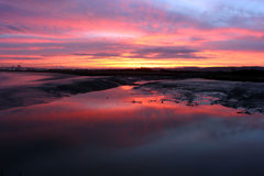 Sunrise over estuary 2 stock image