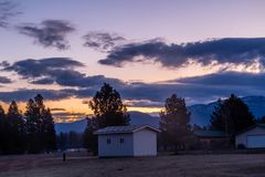 Sunrise over a famers field, Columbia, Montana, United States royalty free stock image