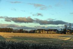 Sunrise over Farm House Stock Photo