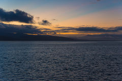 Sunrise over Fernandina with low clouds. Ecuador Stock Image