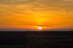 Sunrise over a field Royalty Free Stock Photo