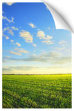 Sunrise over the field poster. Poster or postcard illusion of a beautiful landscape : Sunrise over a newly planted fields beautiful, dramatic HDR rendering Royalty Free Stock Photos