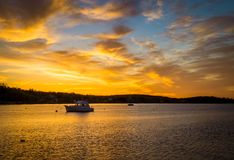 Sunrise over a fishing boat. On the Atlantic ocean in Nova Scotia Stock Photos