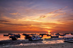 Sunrise over fishing boats on Bali Stock Photography