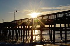Sunrise over the fishing pier stock image