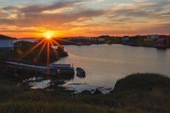 Sunrise over fishing stages on change Islands. Change Islands, Newfoundland & Labrador Royalty Free Stock Photos