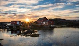 Sunrise over fishing stages on changeIslands. Change Islands, Newfoundland & Labrador Stock Images