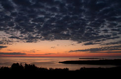 Before sunrise over Flat Island. Low clouds on golden hour before sunrise over Flat Island (Ile Plate), Gulf of Saint Lawrence, Gaspe peninsula, Quebec Royalty Free Stock Photography