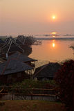 Sunrise over the floating cottages Stock Photos