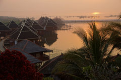 Sunrise over the floating cottages Royalty Free Stock Photo