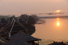 Sunrise over the floating cottages Royalty Free Stock Images