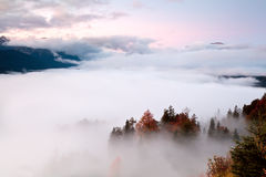 Sunrise over fog in Alps Royalty Free Stock Photos