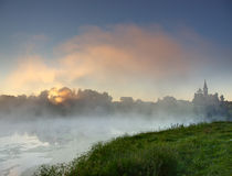 Sunrise over foggy lake Royalty Free Stock Photo
