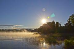 Sunrise over foggy lake Royalty Free Stock Image