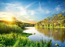 Sunrise over the forest river Royalty Free Stock Images