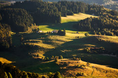 Sunrise over forested hills Royalty Free Stock Image