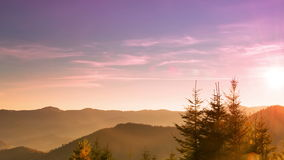 Sunrise over the Forested Mountains. Time Lapse 4K. Autumn. Forested Ukrainian Carpathian mountains. Dawn. Time lapse 4K