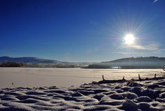Sunrise over a frozen lake. In blessington county wicklow in ireland Stock Image