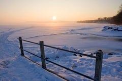 Sunrise over frozen lake Royalty Free Stock Photos