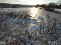 Sunrise over the frozen lake Stock Photography